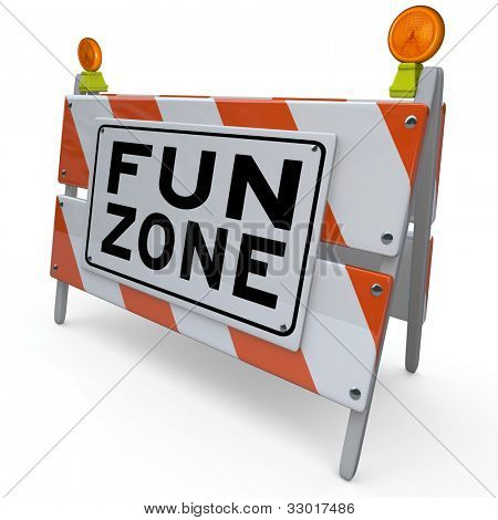 An orange and white construction barricade sign reading Fun Zone to indicate an area set aside for playing, entertainment, games and other activities for