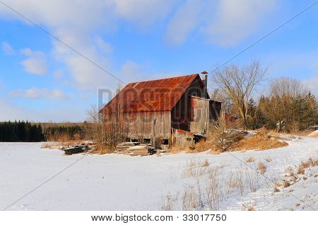 Old house in winter landscape in Bromont, Quebec , Canada