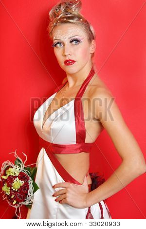 beautiful young bride wearing in white dress with red ribbons on red background