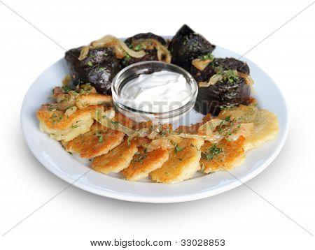 Potato pancakes and blood sausage