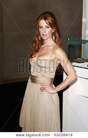 BEVERLY HILLS, CA - JUNE 16: Poppy Montgomery at the 2011 Women In Film Crystal + Lucy Awards at the Beverly Hilton Hotel in Beverly Hills, California on June 16, 2011.