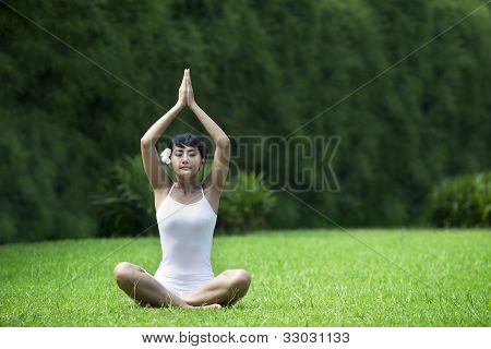 Sweet Asian Woman Meditating Outdoor