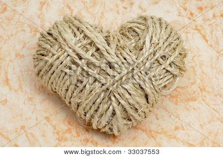 heart-shaped coil of rope on a marmoreal background