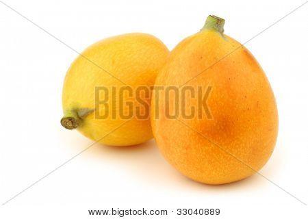 fresh loquat fruit (Eriobotrya japonica) on a white background