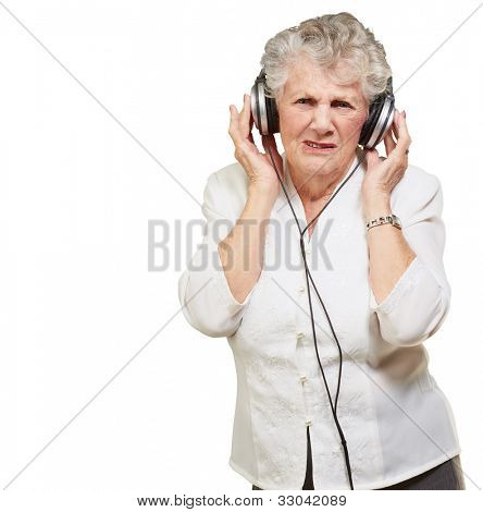 portrait of a senior woman listening to music over a white background