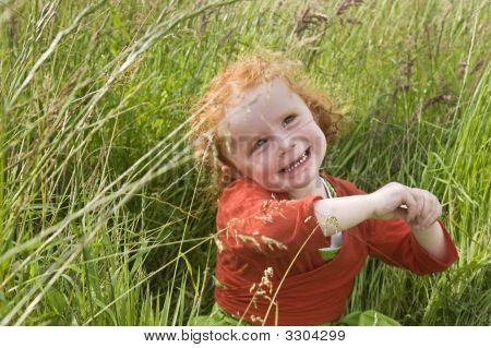 Little Girl In Grass Field