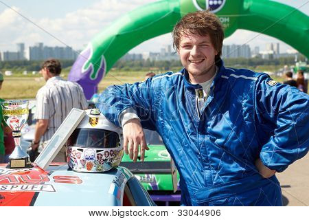 MOSCOW - JUNE 11: Aleksey Titov - participant, who takes 3-d place in 3-d tour in summer cup of Megafon mitjet race at Moscow racetrack