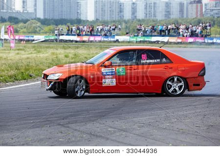 MOSCOW - JUNE 11: Red racing car with pilot D.Kharchenko rides on the track of Moscow racetrack MegaFon Tushino Ring  at Megafon mitjet race, June 11, 2011, Moscow, Russia.