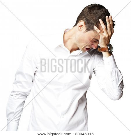 Angry young man doing a frustration gesture over a white background