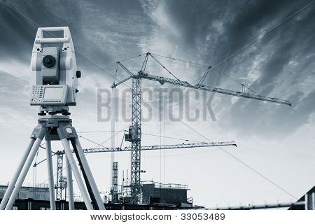 geodesy instrument, total-station with building site. duplex blue toning idea
