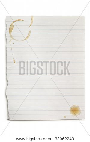 Torn white notepaper with coffee stains, isolated on white with soft shadow.