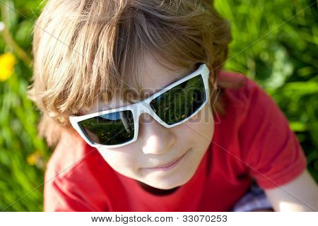 The Fair-haired Boy In Sunglasses
