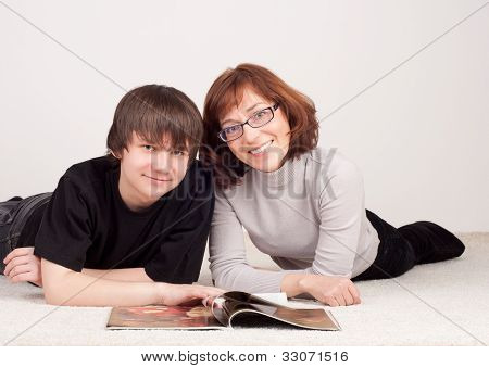 mother and son are together, read magazine