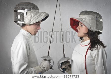 Two fencers facing each other before the match