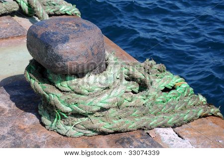 Bollard And Rope In The Port