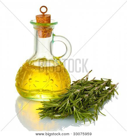 Oil in a bottle and fresh rosemary isolated on white