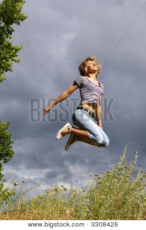 Beautiful Young Woman Jumps