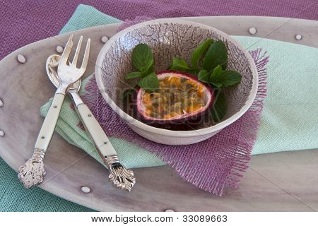 Granadilla With Mint And Spoon And Fork