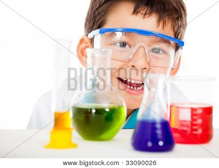 Happy little scientist playing at the lab - isolated over a white background