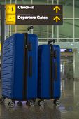 Two Suitcases Of Blue Color In The Airport Departure Lounge, Summer Vacation Concept, Traveler Suitc poster