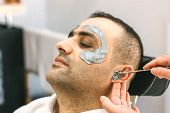 Male Face Waxing. Barber Removes Hair By Shugaring From The Face Of Turkish Man. poster