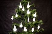 Light-emitting Diode Or Led Lamps Hanging On Christmas Tree. White Matte Energy-efficient, Energy Sa poster