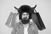 Dissatisfied With Purchase. Unhappy Hipster With His Purchase In Paperbags Hanging On Bull Horns. Br poster