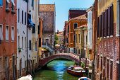 Grand Canal In Venice With Boats And Gandules Docket Motor Boat Near The Bridge. Colorful Residentia poster