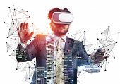 Businessman Wearing Vr Headset Working With Virtual System. New Reality Modeling And Design. Interac poster