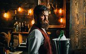 Handsome Bearded Barman With Long Beard And Mustache Has Stylish Hair On Serious Face. Man In Vintag poster