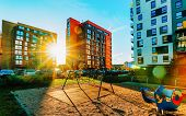 Modern Residential Apartment And Flat Building Exterior And Outdoor Playground poster