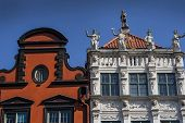 Top Of Old Historic Tenement Houses With Large Sculptures And Carvings At Long Market In Gdansk, Pol poster