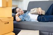 Exhausted, Tired Young Asian Woman Working Overnight And Sleep At Couch With Packing Box Feels Exhau poster