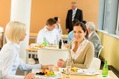 stock photo of canteen  - Cafeteria lunch young business women eat salad at office canteen - JPG