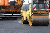 image of paved road  - Road roller and asphalt paving machine at construction site - JPG