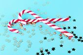 Christmas Candy Canes With Golden Decorations And Sparkles On Pastel Blue Background. Minimal Compos poster