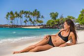 Beach summer vacation woman sun tanning in bikini relaxing enjoying Hawaii holidays travel. Suntan b poster