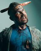 Zombie Portrait. Realistic Halloween Makeup, Bloody Zombies With A Knife In The Head, poster