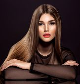 Woman with beauty long brown hair. Beautiful  model with long straight hair. Model with a smokey mak poster