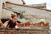 Young Woman Sightseeing In Medieval Town Of Certaldo In Tuscany, Italy poster