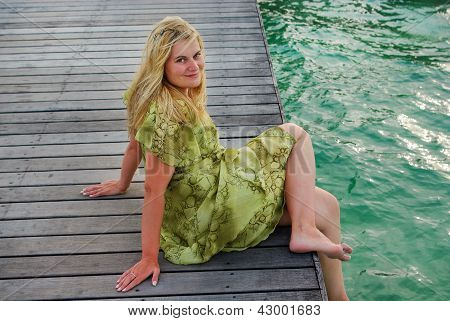 Young Woman Landing Stage On Beach On Maldives