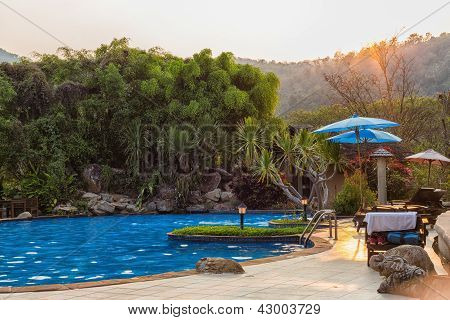 Outdoor Swimming Pool In Sunset Time