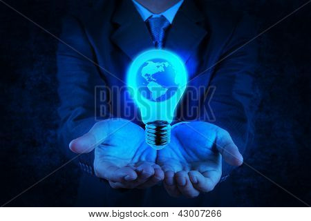 Businessman Hand Shows Light Bulb With Planet Earth