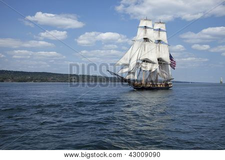 Tall Ship With American Flag Sailing On Blue Waters
