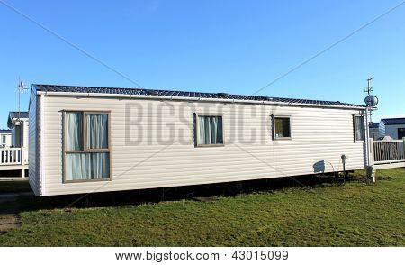 Exterior of modern caravan in trailer park.
