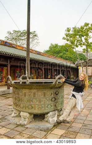 Young tourist in Imperial City (Citadel) in Hue, Vietnam