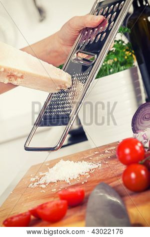 Retro Image Of Ingredients For Pasta And Hands Grating Parmesan