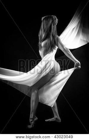 Beautiful woman with white tissue on black background