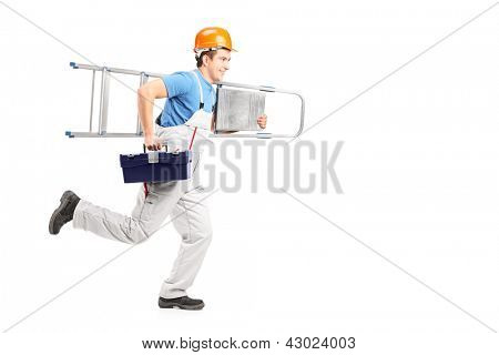 Full length portrait of a repairman running with a ladder and a tool box isolated against white background