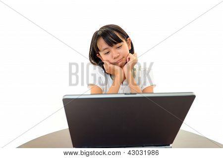 Bored girl sitting at her desk
